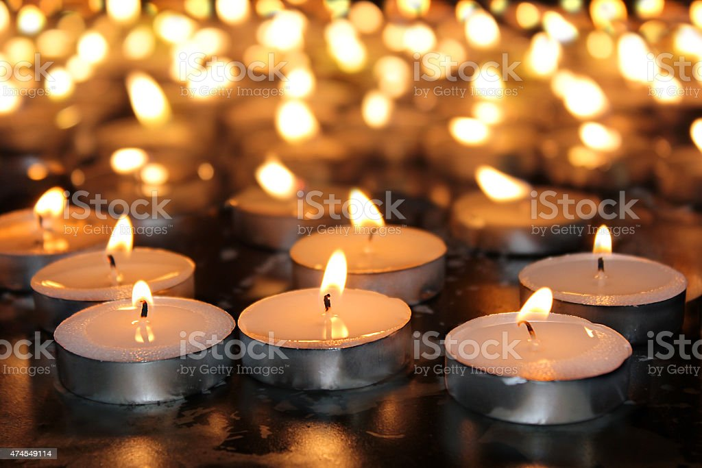 burning memorial candles stock photo