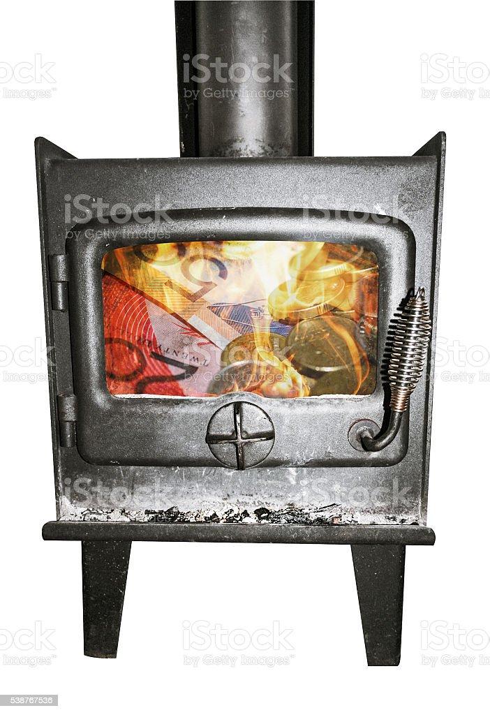 Burning money in fireplace. stock photo