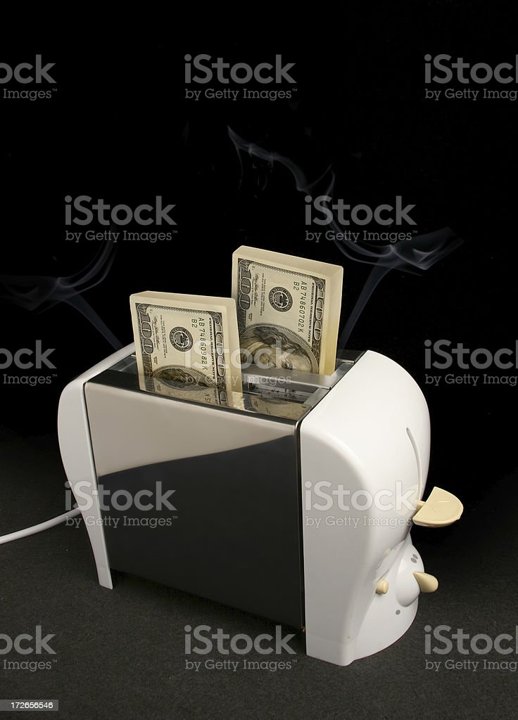 Burning money or making money? stock photo