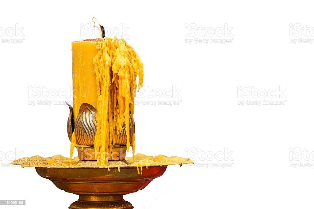 burning of candle on candlestick stock photo