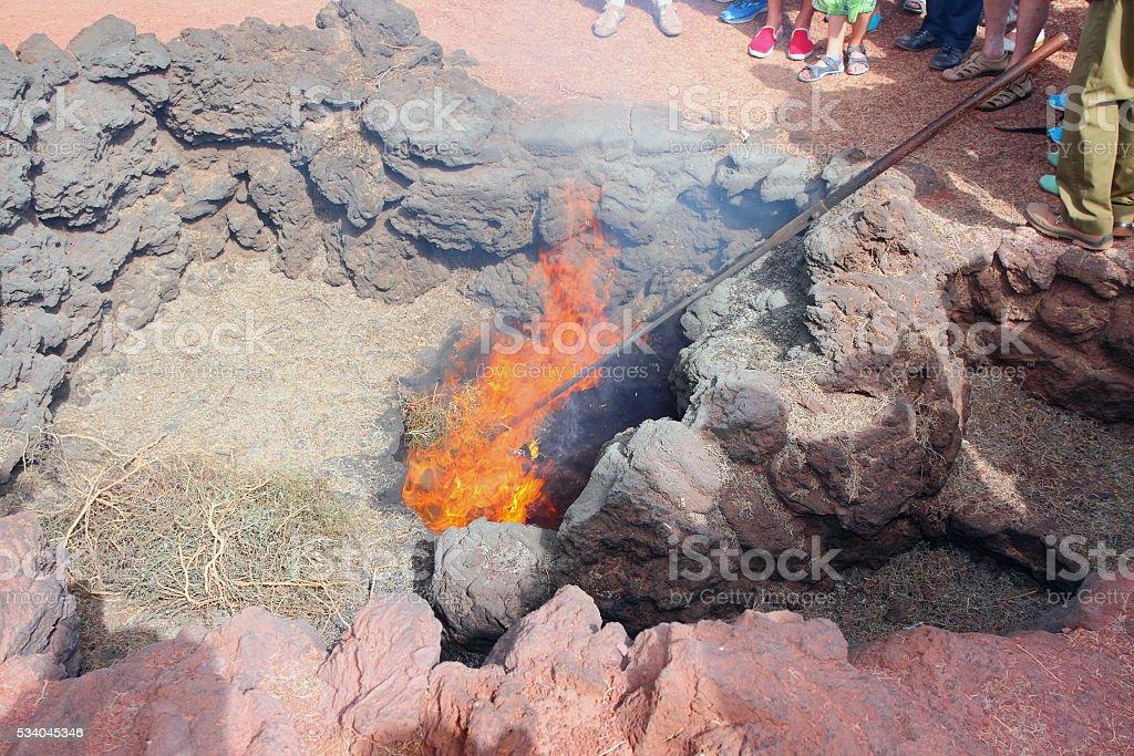 Burning of straw from volcanic heat. Timanfaya, Lanzarote, Spain stock photo