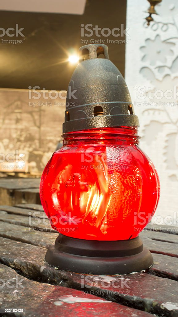 Burning oil lamp on burlap. Vintage concept stock photo