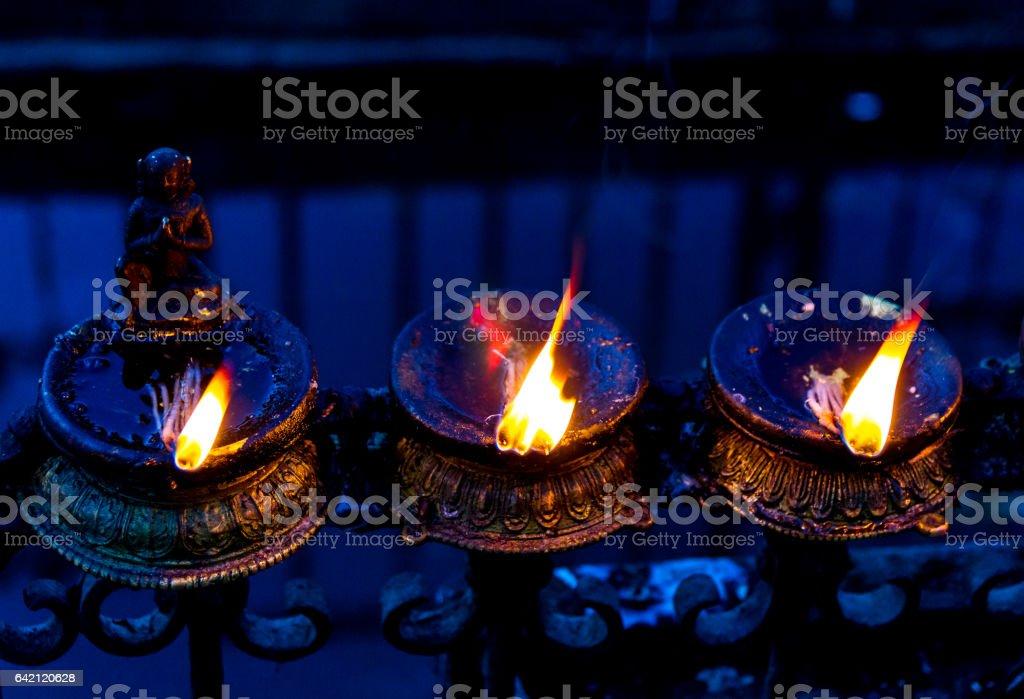 Burning Oil Lamps at Swayambhunath Stupa stock photo