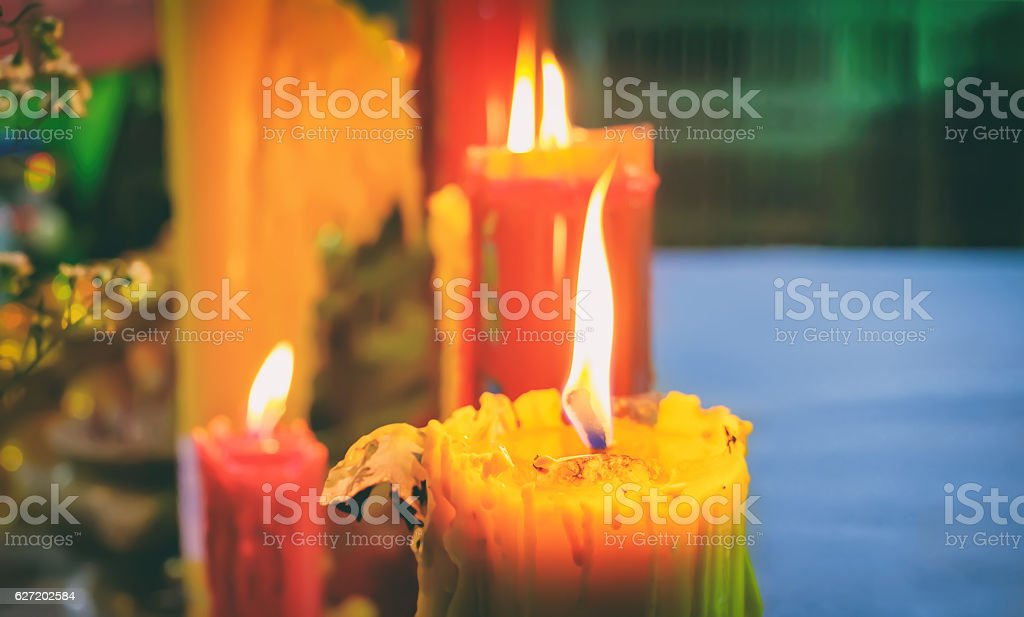Burning old textured candles stock photo
