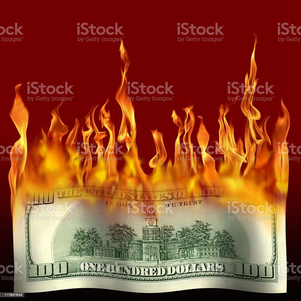burning one hundred dollar bill stock photo