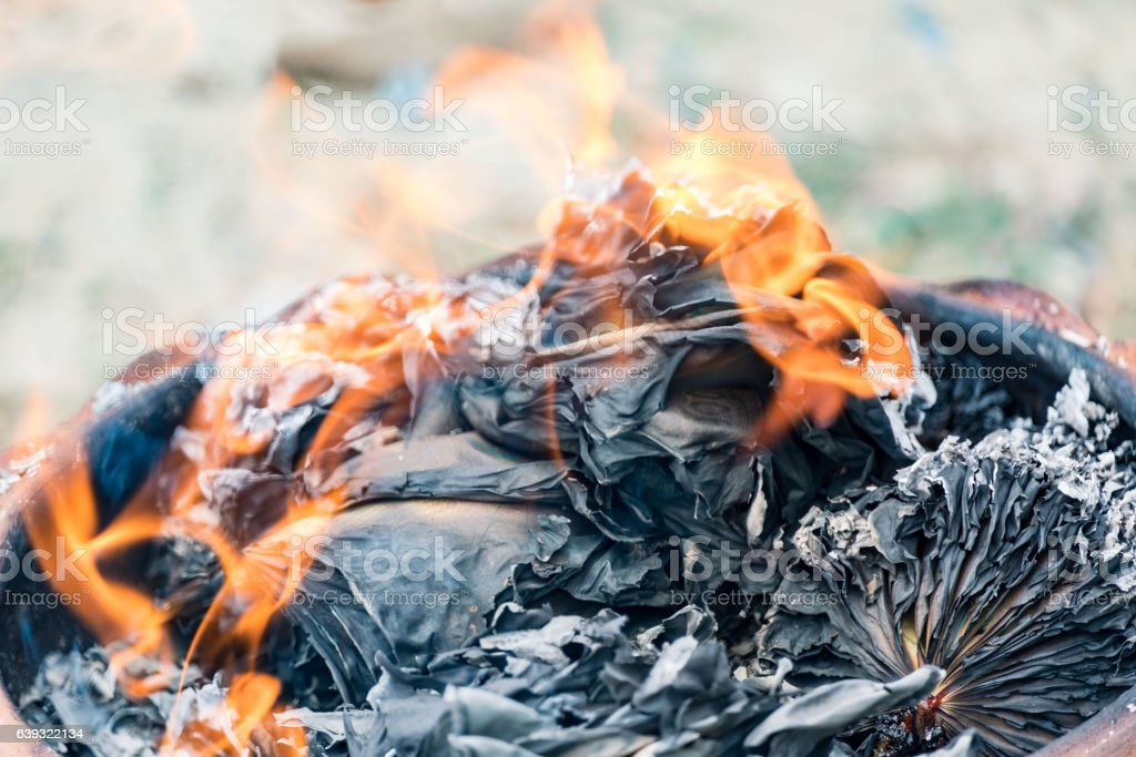 Burning paper silver and gold in festival stock photo