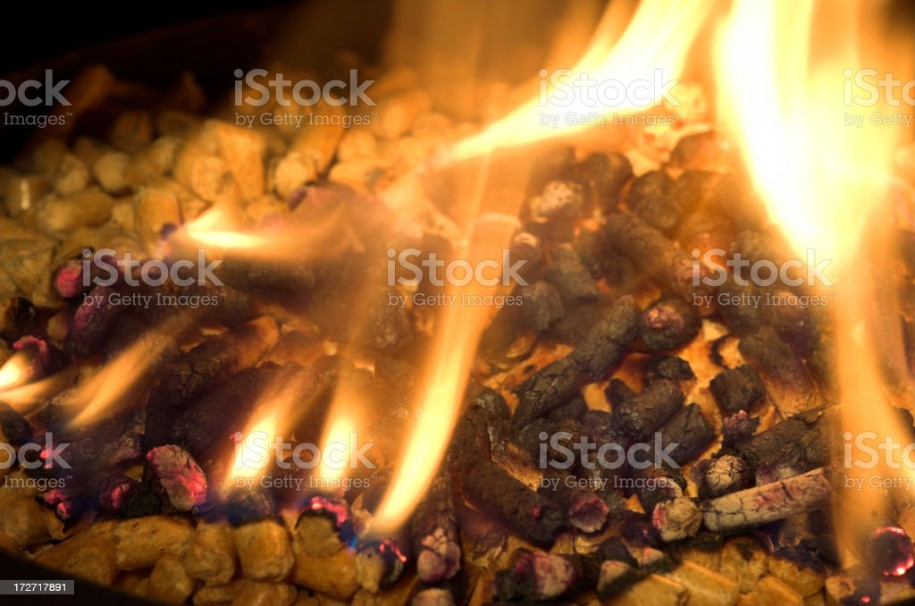 Burning pellets stock photo