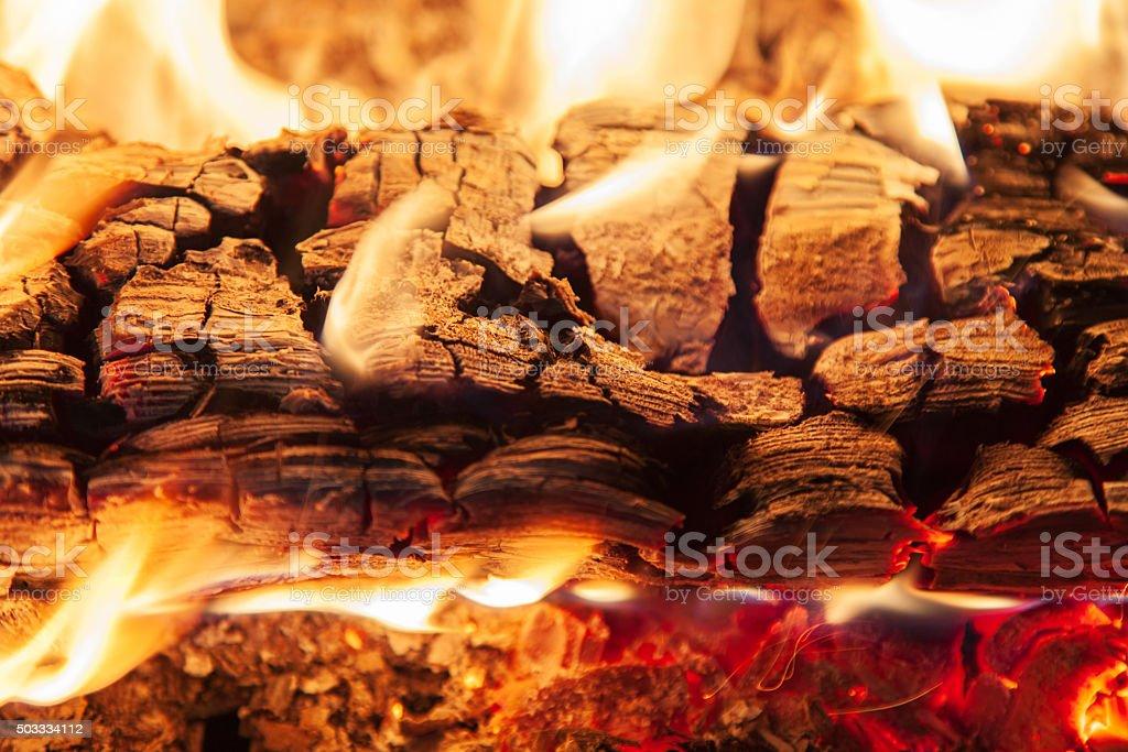 Burning piece of wood stock photo