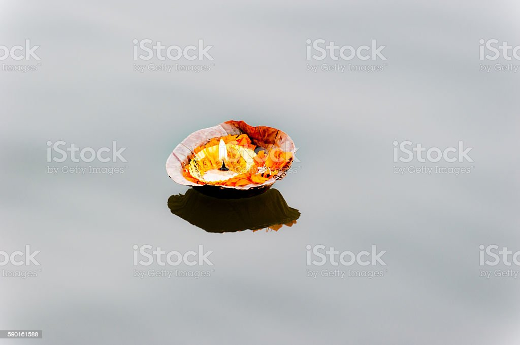 Burning pooja candle at aarti ceremony on the Ganges, Varanasi stock photo
