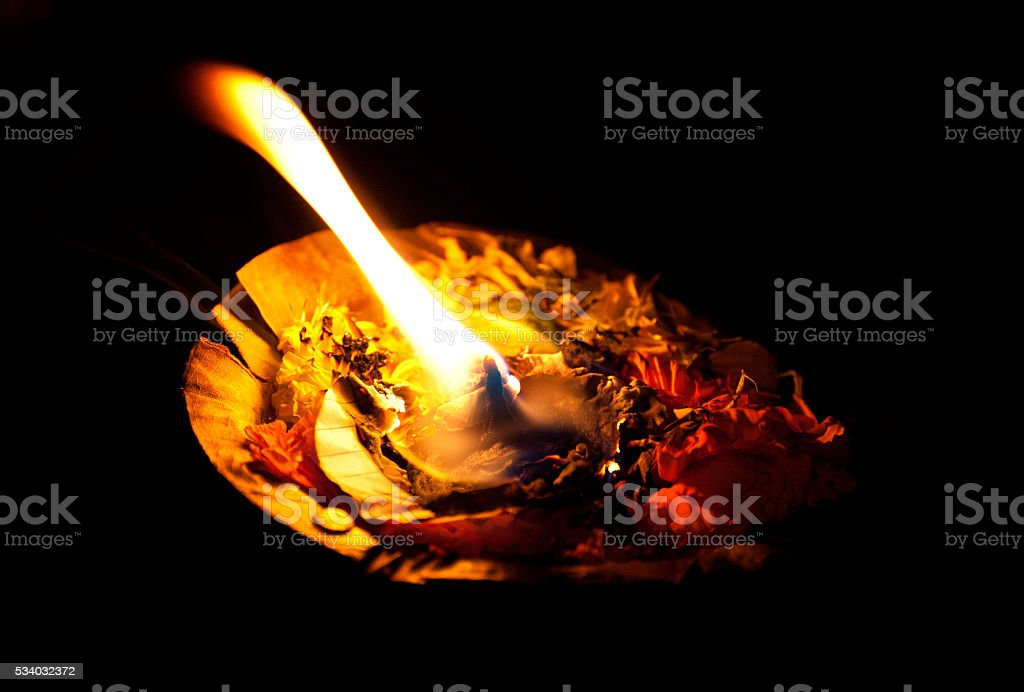 Burning pooja candle at night on the Ganges, Varanasi, India stock photo