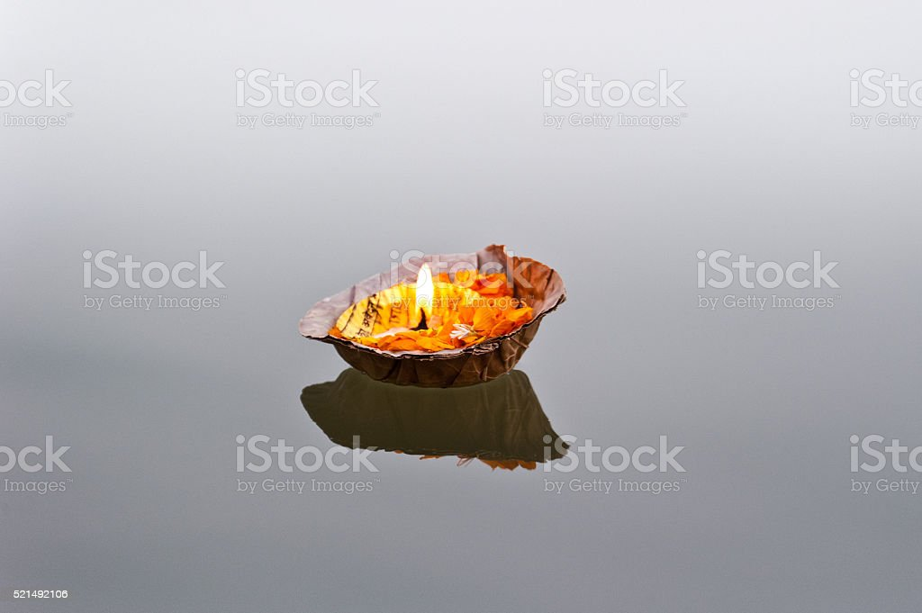 Burning pooja candle on the Ganges stock photo