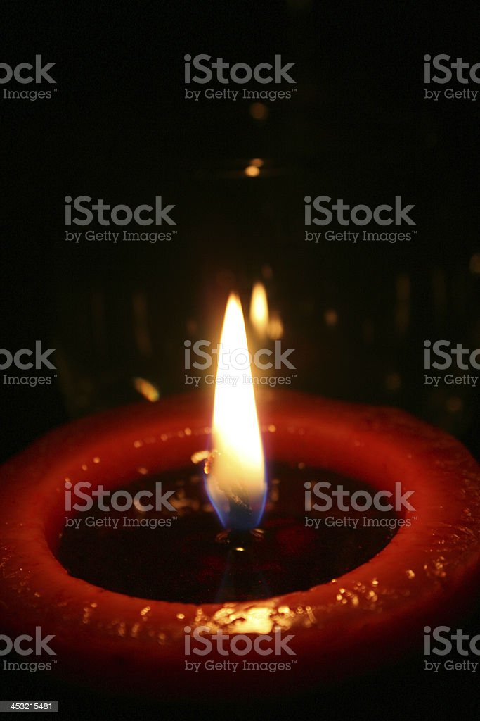 Burning red candle royalty-free stock photo