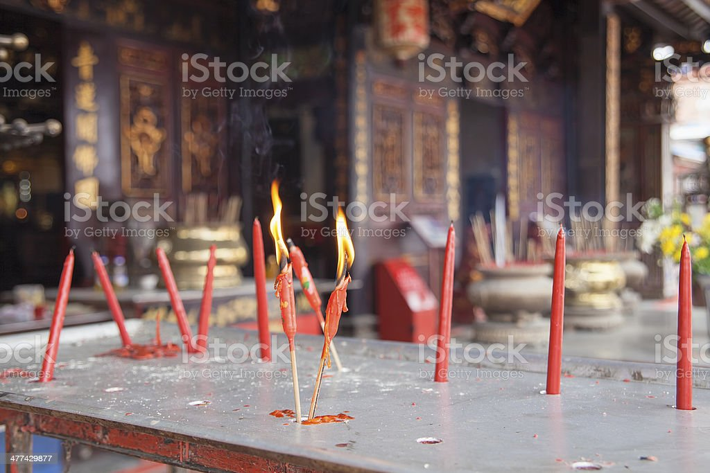 Burning Red Candles at Chinese Temple stock photo
