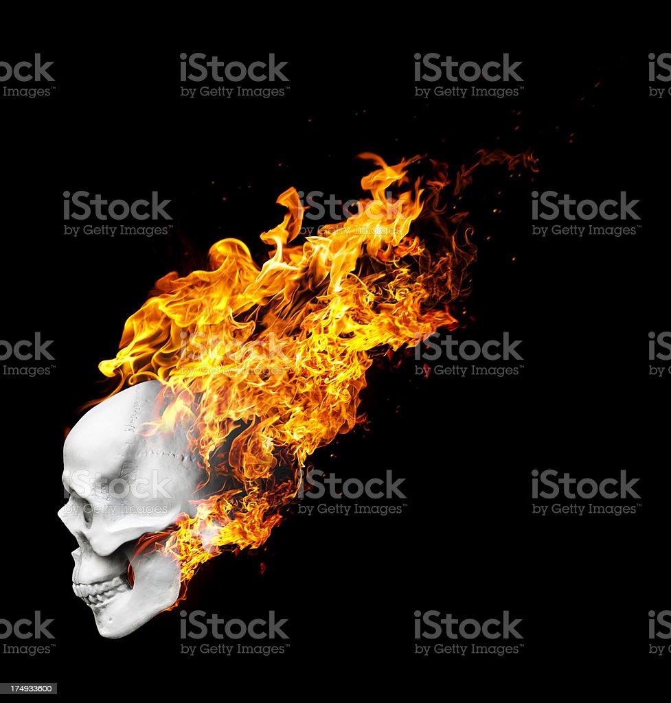 Burning skull falling down royalty-free stock photo