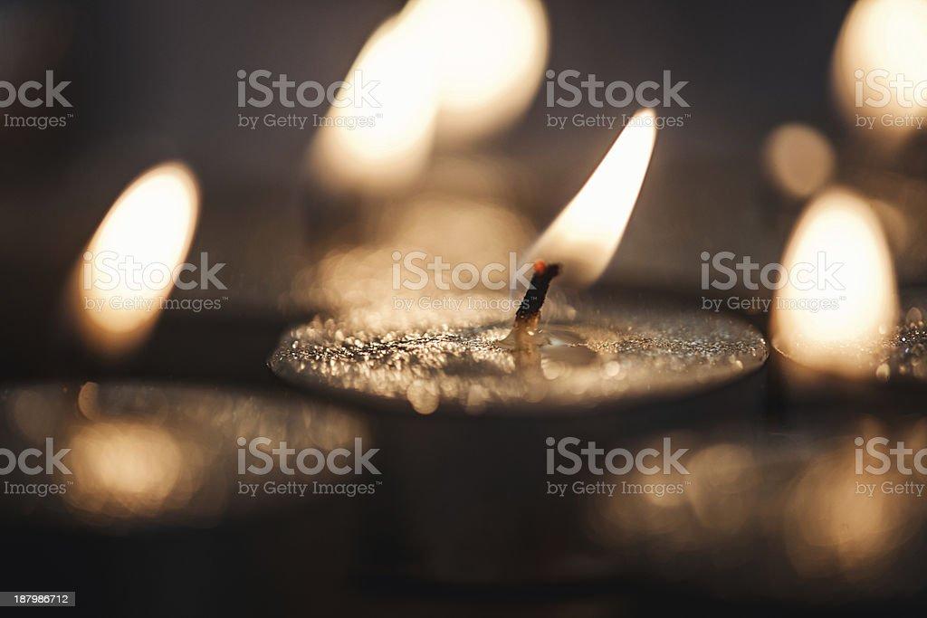 Burning tea lights stock photo