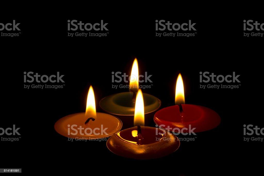 burning tealights in the dark stock photo