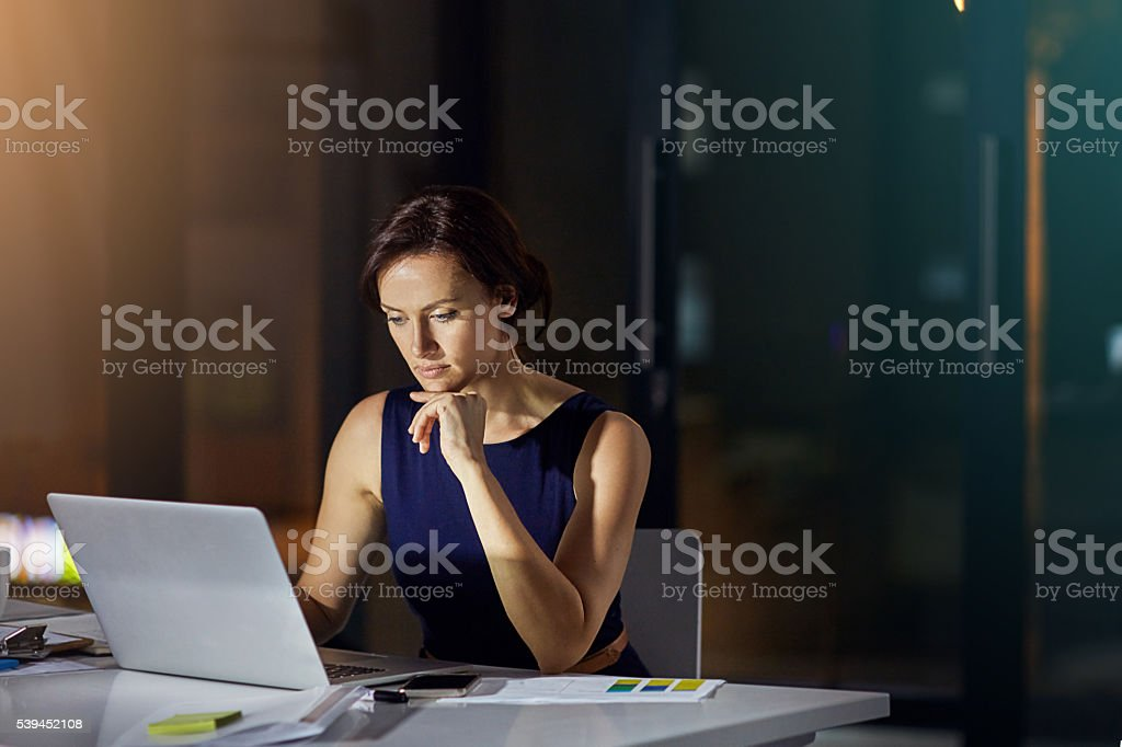 Burning the midnight oil stock photo