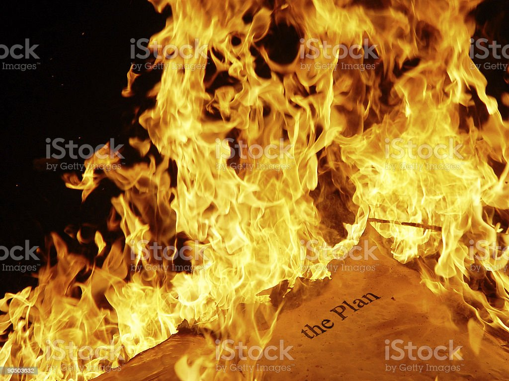 burning the old plan stock photo