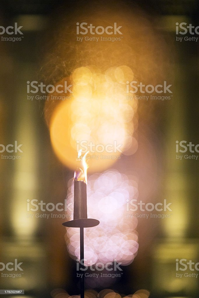 Burning torch in front of an old European castle royalty-free stock photo