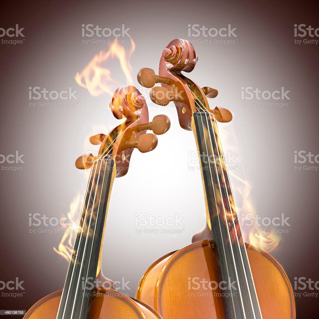 Burning two violin royalty-free stock photo