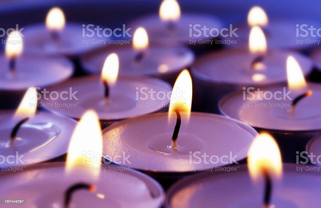 Burning violett candles background stock photo