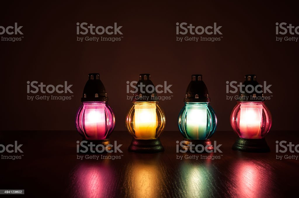 Burning votive candles in the dark stock photo