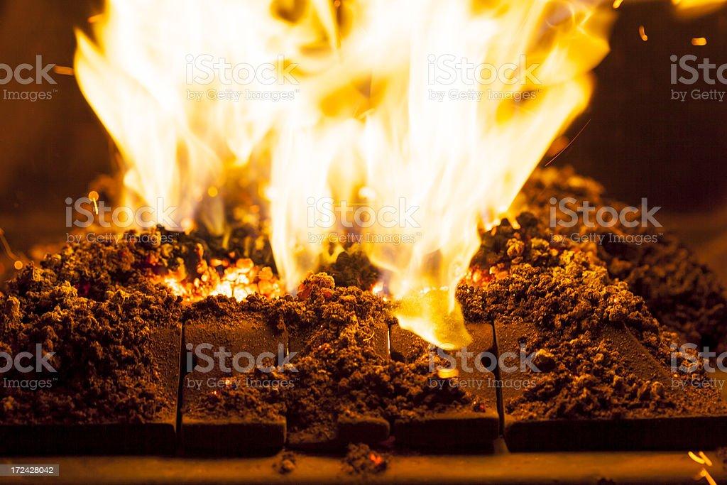 Burning wood pellets stock photo