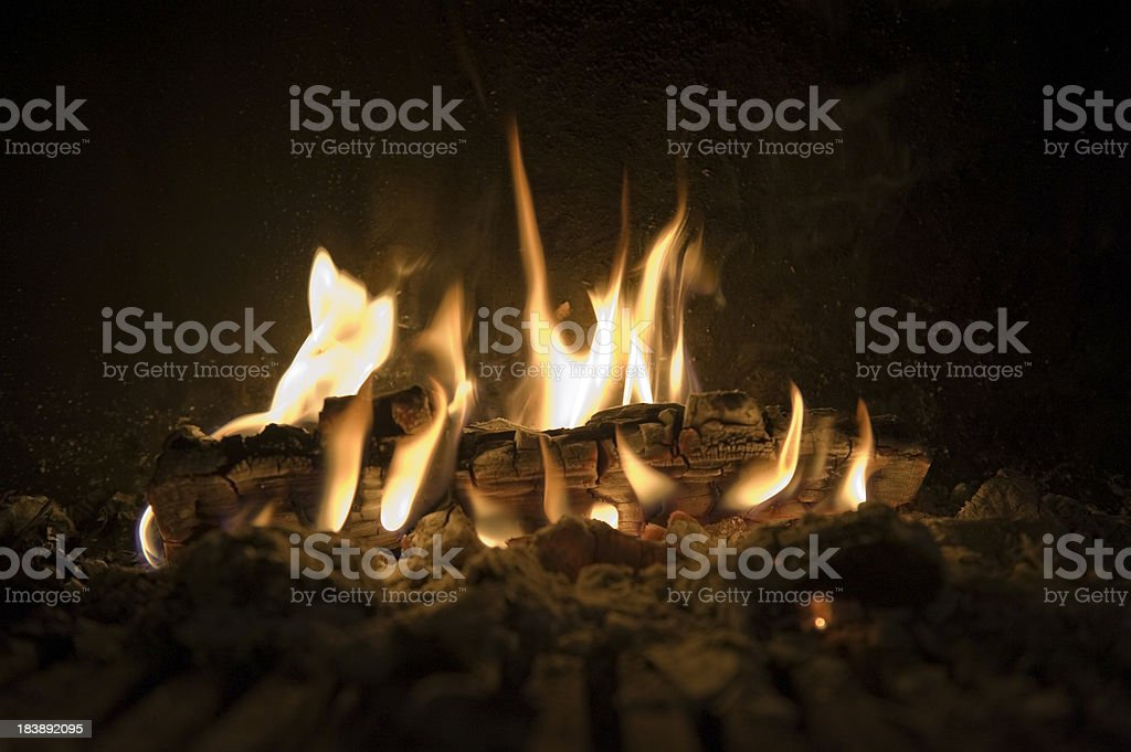 burning wood with flames in a fireplace royalty-free stock photo