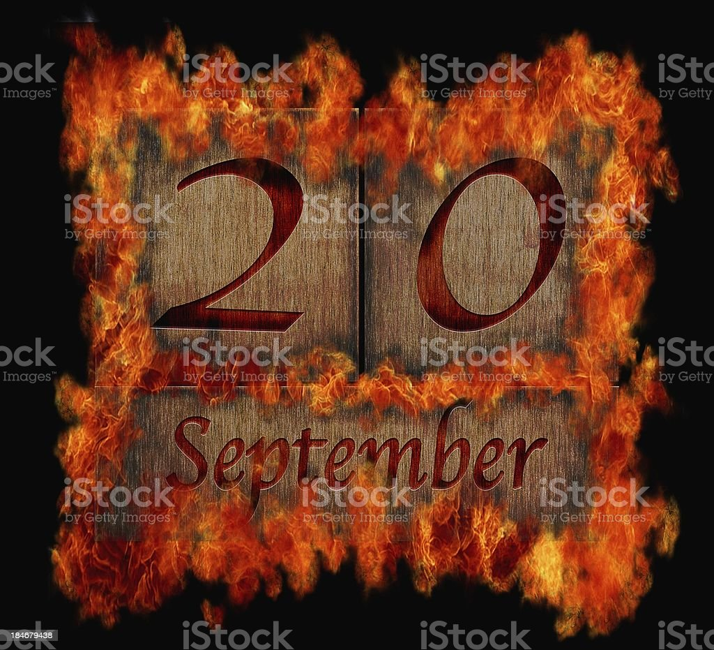 Burning wooden calendar September 20. royalty-free stock photo