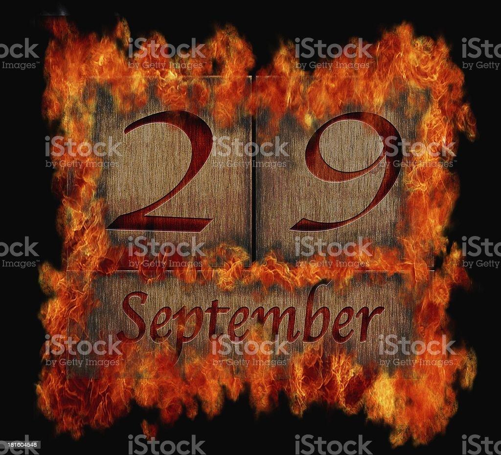 Burning wooden calendar September 29. royalty-free stock photo