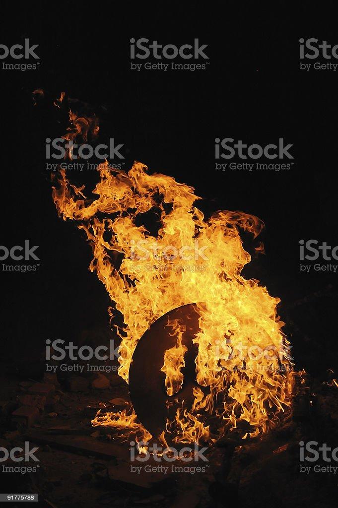 Burning wooden spool royalty-free stock photo