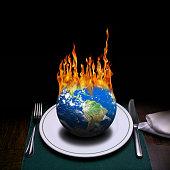 burning world on dinner table