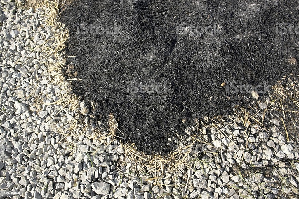 burnt border with ash and stones stock photo