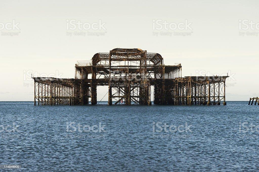 Burnt Brighton West Pier at sunrise royalty-free stock photo