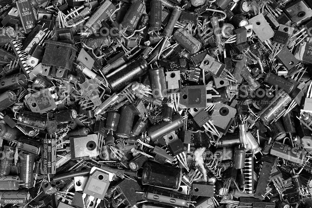 Burnt electronic components as technology waste background stock photo