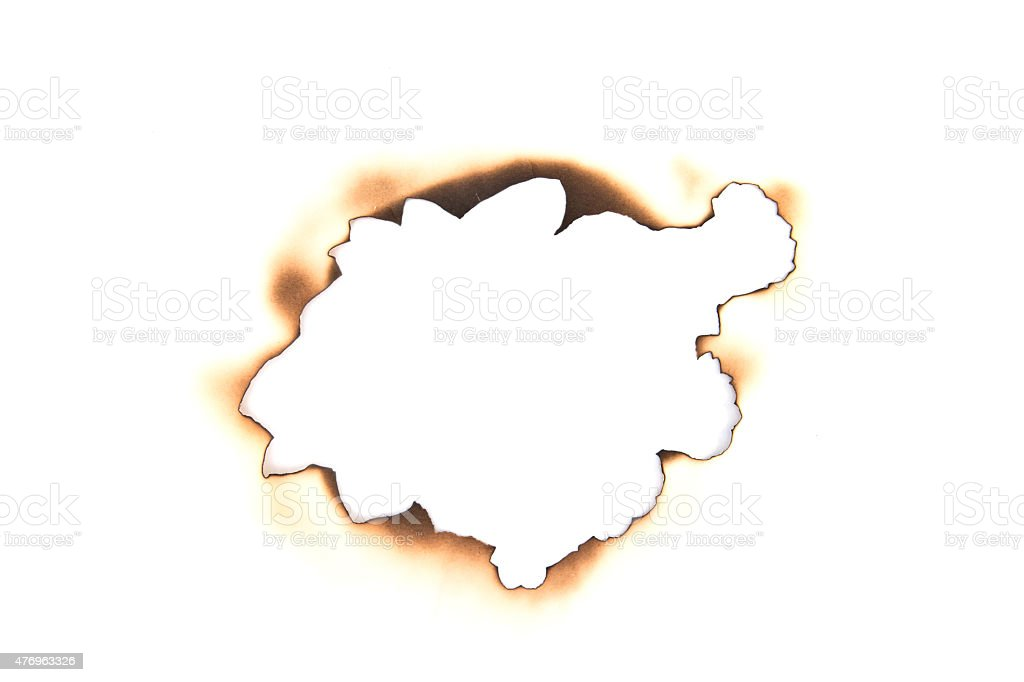 burnt hole in a paper stock photo
