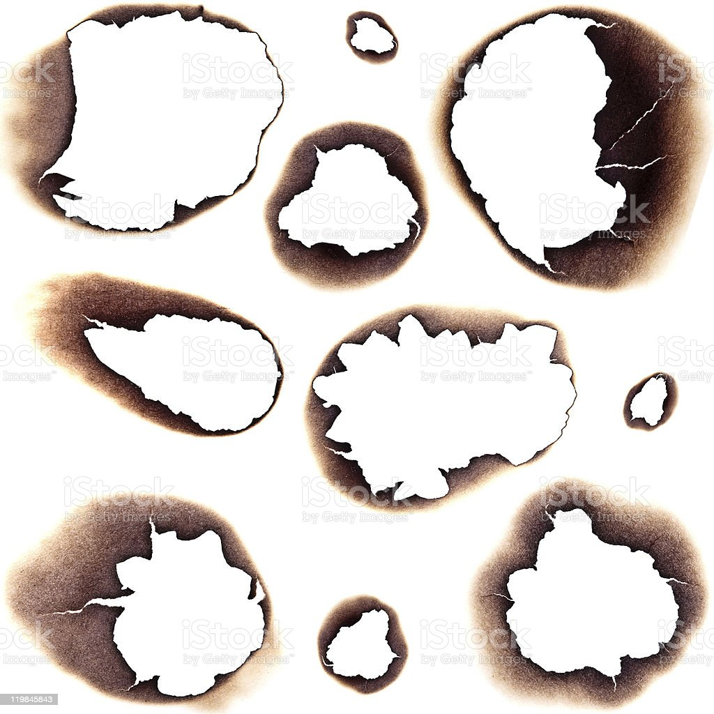 Burnt Holes in White Paper stock photo