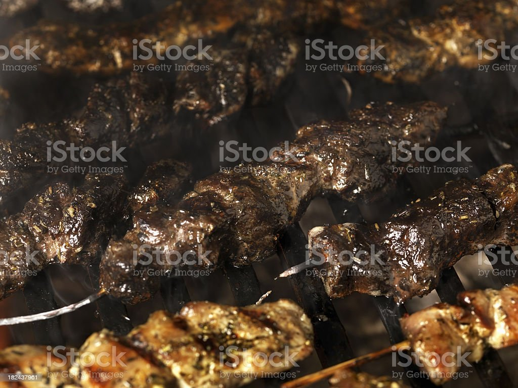 Burnt Meat Skewers on the BBQ stock photo