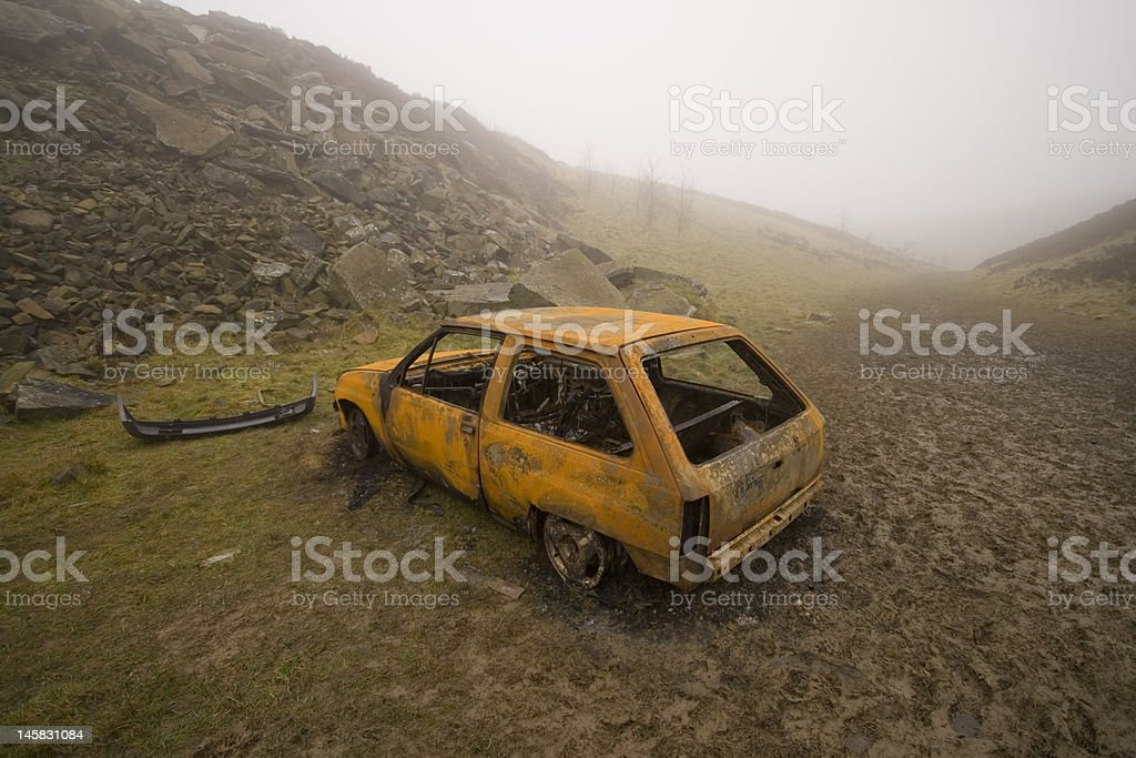 Burnt out and rusted car royalty-free stock photo