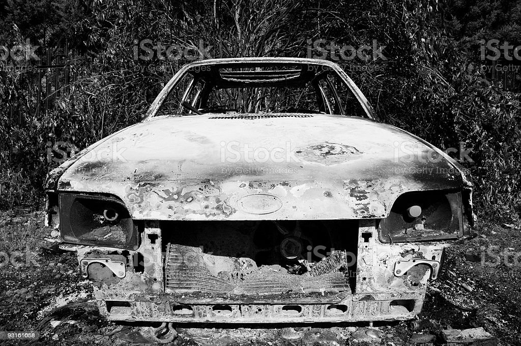 burnt out car - black and white stock photo