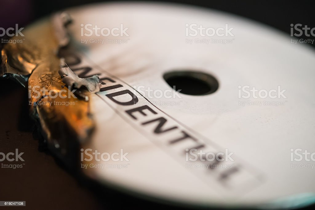burnt out confidential compact disc on black stock photo