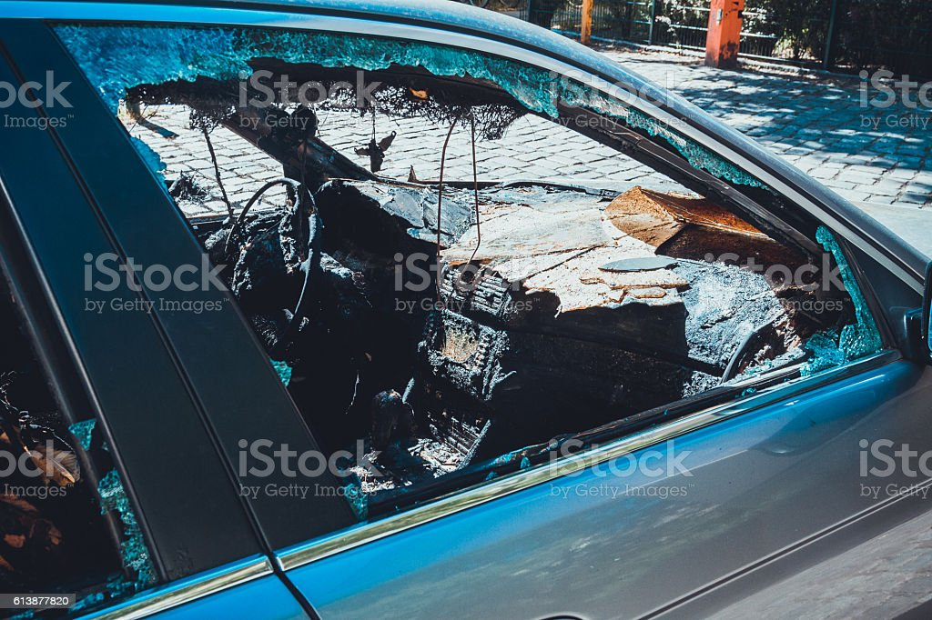 burnt out luxury car stock photo