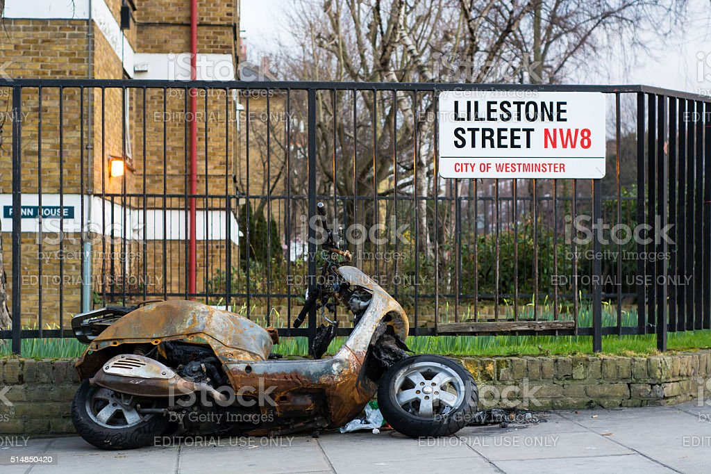 Burnt out moped in central London stock photo
