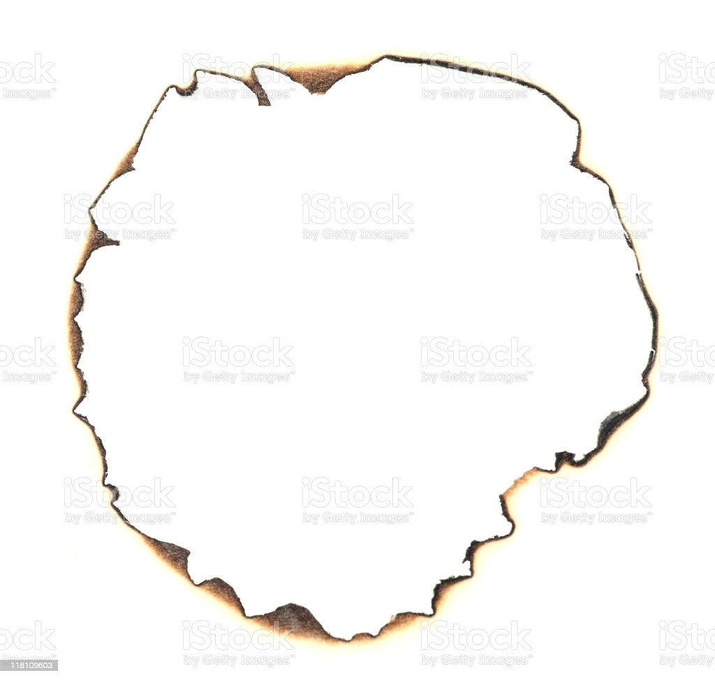 Burnt paper hole stock photo