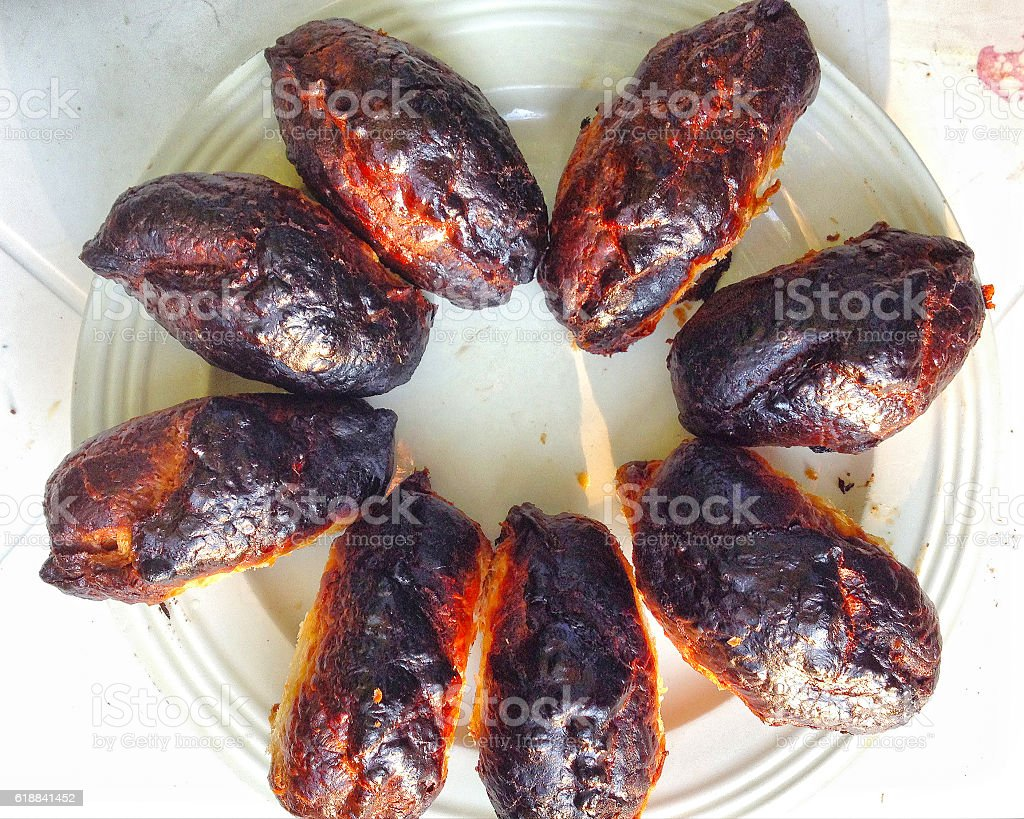burnt pies with black crust on the plate stock photo