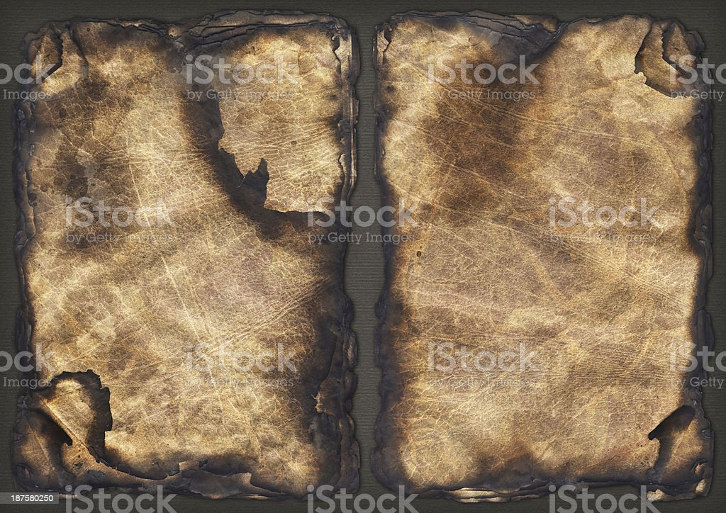 Burnt Pile of Parchment Sheets Vignette Grunge Texture royalty-free stock photo