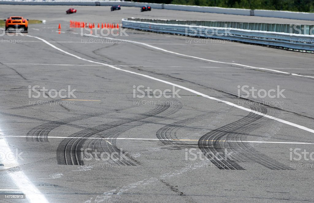 Burnt rubber on a race track stock photo