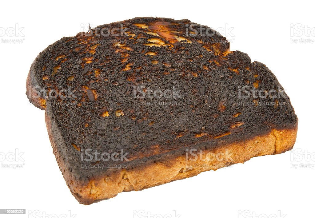 Burnt toast isolated on a white background stock photo