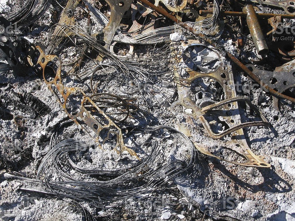 Burnt Waste Car And Other Vehicle Parts From Garage royalty-free stock photo