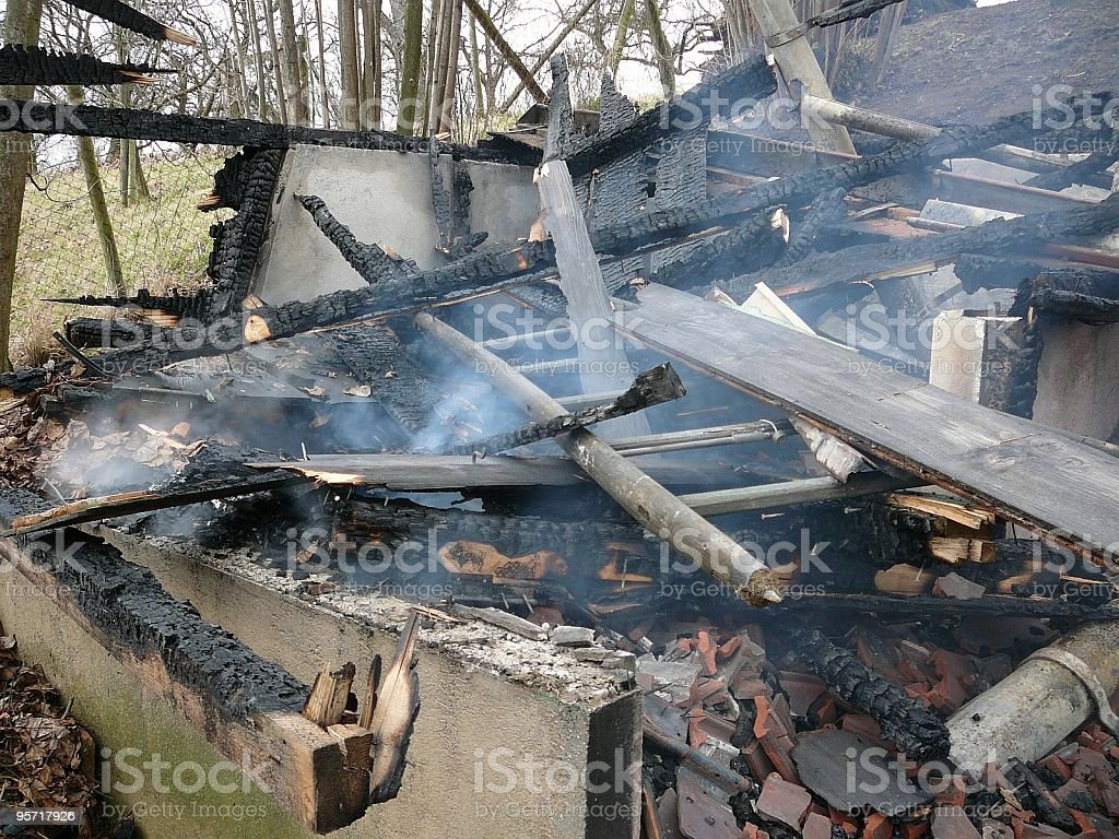 Burnt wooden house royalty-free stock photo